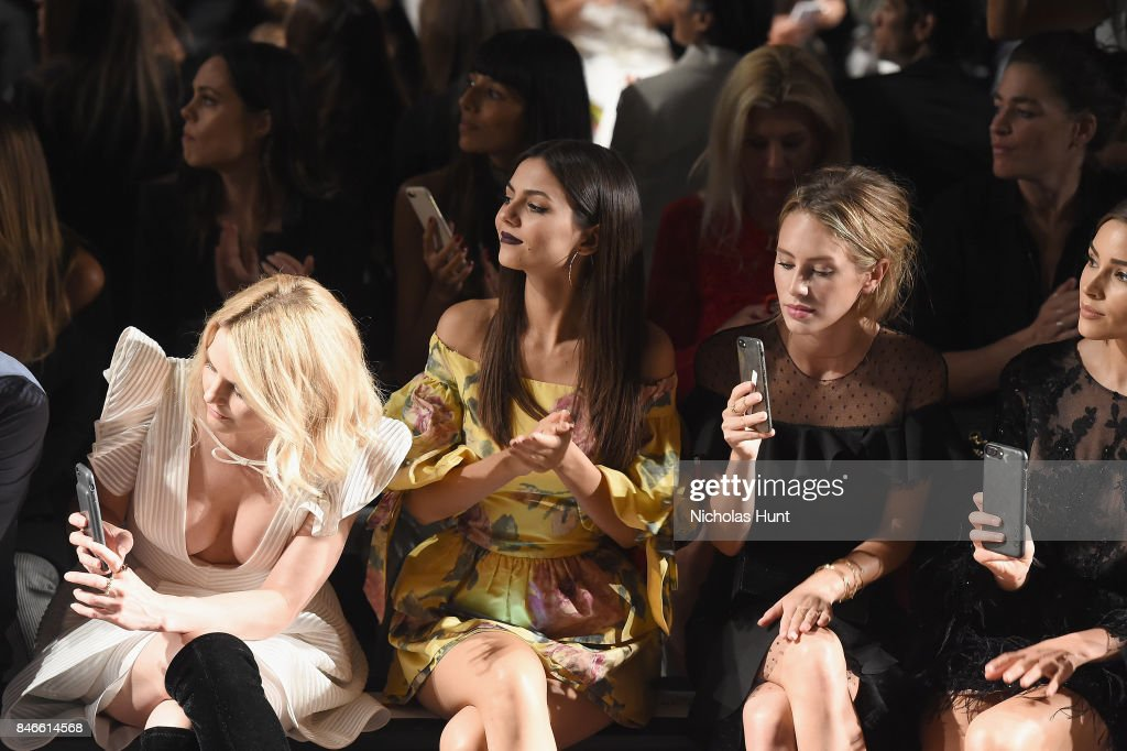 Jennifer Morrison, Victoria Justice and Dylan Penn attend the Marchesa fashion show during New York Fashion Week: The Shows at Gallery 1, Skylight Clarkson Sq on September 13, 2017 in New York City.