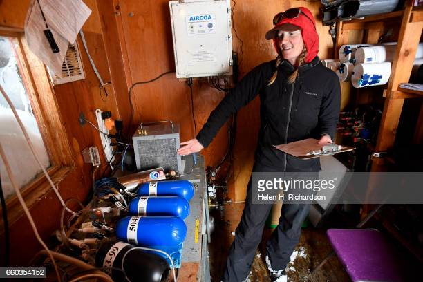 Jennifer Morse a climate technician at the Mountain Research Station in Roosevelt National Forest collects samples of air inside a small wood shed at...