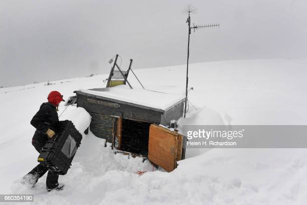 Jennifer Morse a climate technician at the Mountain Research Station in Roosevelt National Forest unloads her data collecting and air sampling...