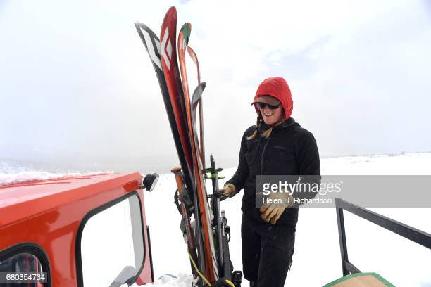 Jennifer Morse a climate technician at the Mountain Research Station in Roosevelt National Forest gets prepared to unload her skis off of the snowcat...