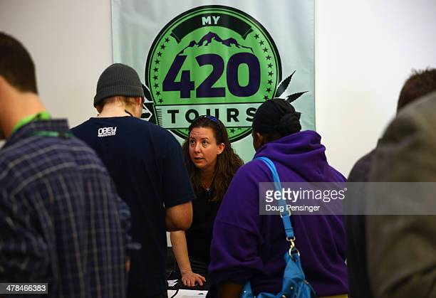 Jennifer Morton of My 420 Tours talks with job seekers at CannaSearch Colorado's first cannabis job fair on March 13 2014 in Denver Colorado OPenVAPE...
