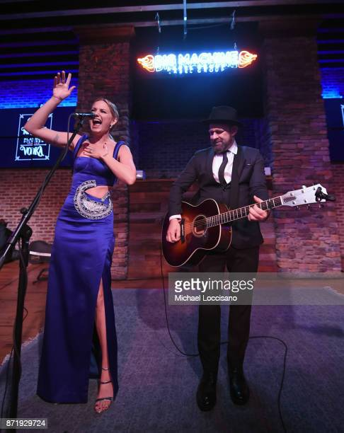 Jennifer Nettles and Kristian Bush of Sugarland perform onstage during the Big Machine Label Group's celebration of the 51st Annual CMA Awards at FGL...