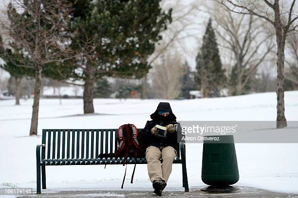 Jennifer Nixon a Denver Zoo employee sits on a bench as she waits for a bus on 28th Temperatures in Denver reached the midteens