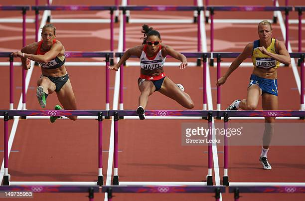 Jennifer Oeser of Germany Louise Hazel of Great Britain and Jessica Samuelsson of Sweden compete in the Women's Heptathlon 100m Hurdles Heat 1 on Day...