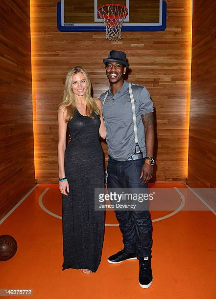Jennifer Ohlsson and Iman Shumpert attend MSG Network's screening of the original series 'MSG Vault's at Clyde Frazier's Wine and Dine on June 14...