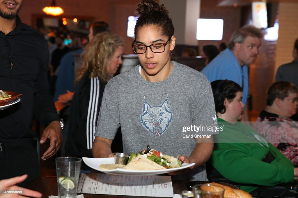Jennifer O'Neill #0 of the Minnesota Lynx serves food during the Tip-A-Lynx fundraiser to benefit the Minnesota Lynx Fastbreak Foundation on June 3, 2015 at the Loop West End Bar & Restaurant in Minneapolis, Minnesota.