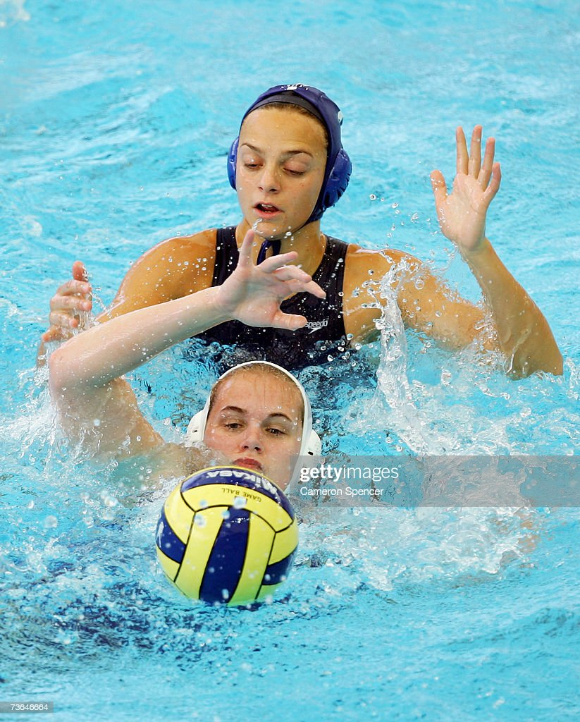Jennifer Pareja Lisalde of Spain and Claudia Blomenkamp of Germany compete for the ball in the Women's Preliminary Round Group A Water Polo match...