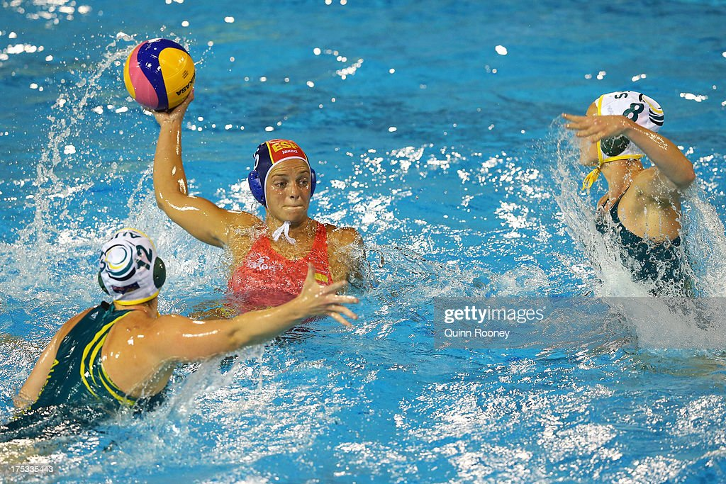 Jennifer Pareja Lisalde of Spain controls the ball against Nicola Zagame and Pilar Pena of Australia during the Women's Water Polo Gold Medal Match...
