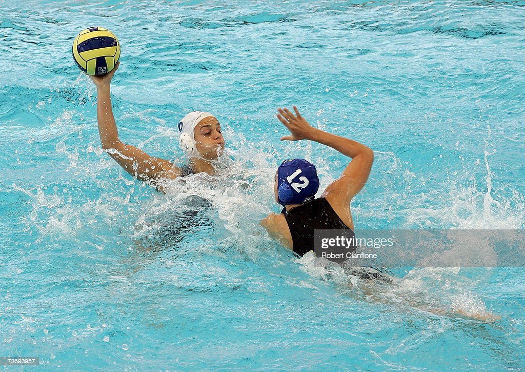 Jennifer Pareja Lisalde of Spain looks to pass with Melina Teno of Brazil in defence during the Women's Final Round Water Polo match between Spain...