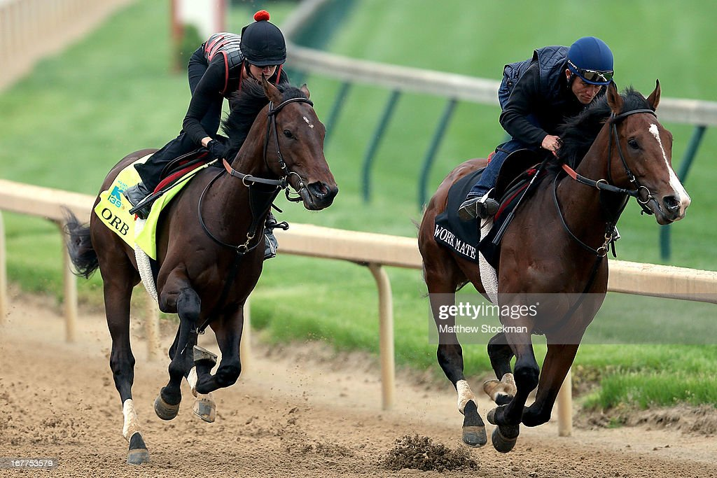 Jennifer Patterson rides Orb (L) during the morning excercise session in preparation for the 139th Kentucky Derby at Churchill Downs on April 29, 2013 in Louisville, Kentucky.