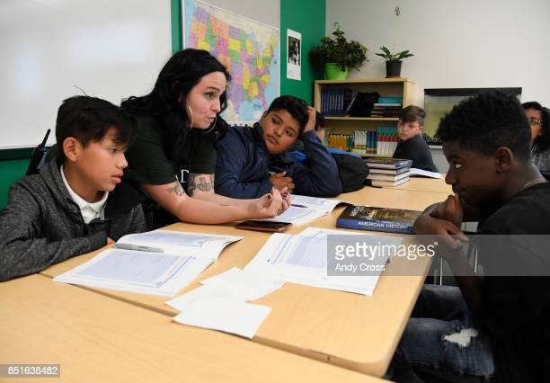 Jennifer Perea second from left assistant Principal at Noel Community Arts School works with students Juan Vera left Randy Lopez third from left and...