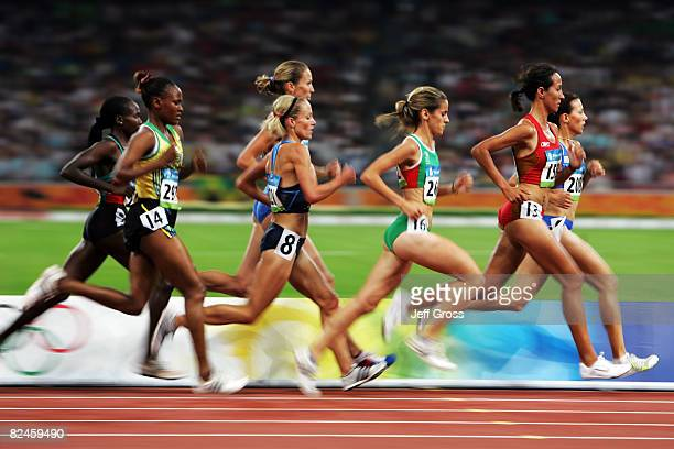 Jennifer Rhines of the United States Jessica Augusto of Portugal and Dolores Checa of Spain compete in the Women's 5000m Heats held at the National...