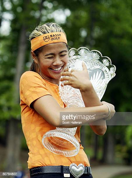 Jennifer Rosales of the Phillipines hugs the trophy after a onestroke victory at the ChickfilA Charity Championship on May 2 2004 at Eagle's Landing...