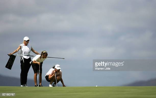 Jennifer Rosales of the Phillippines lines up a putt on the 10th green with her compatriot Dorothy Delesin during the 2005 Women's World Cup of Golf...