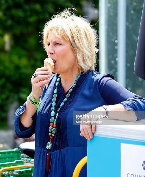 Jennifer Saunders eats an ice cream as she attends the VIP preview day of The Chelsea Flower Show at The Royal Hospital Chelsea on May 19 2014 in...