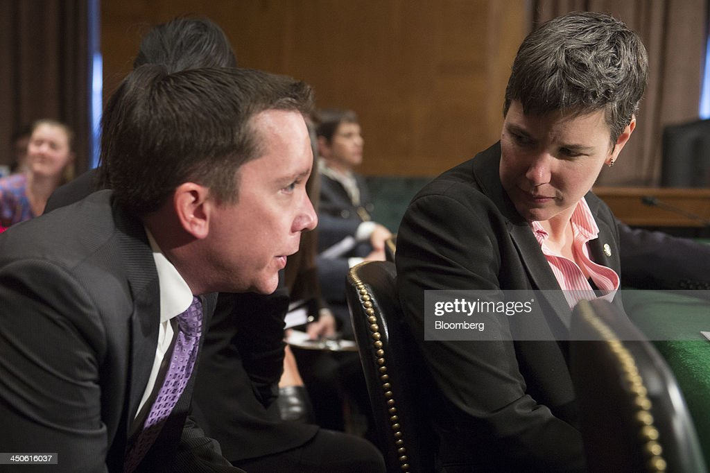Jennifer Shasky Calvery, director of financial crimes enforcement network with the U.S. Treasury, right, waits to start a Senate Banking Subcommittee hearing on virtual currency in Washington, D.C., U.S., on Tuesday, Nov. 19, 2013. Bitcoin's rally is accelerating as the U.S. Department of Justice's description of the digital currency as a 'legal means of exchange' bolsters the prospect of wider acceptance as an alternative payment system. Photographer: Andrew Harrer/Bloomberg via Getty Images