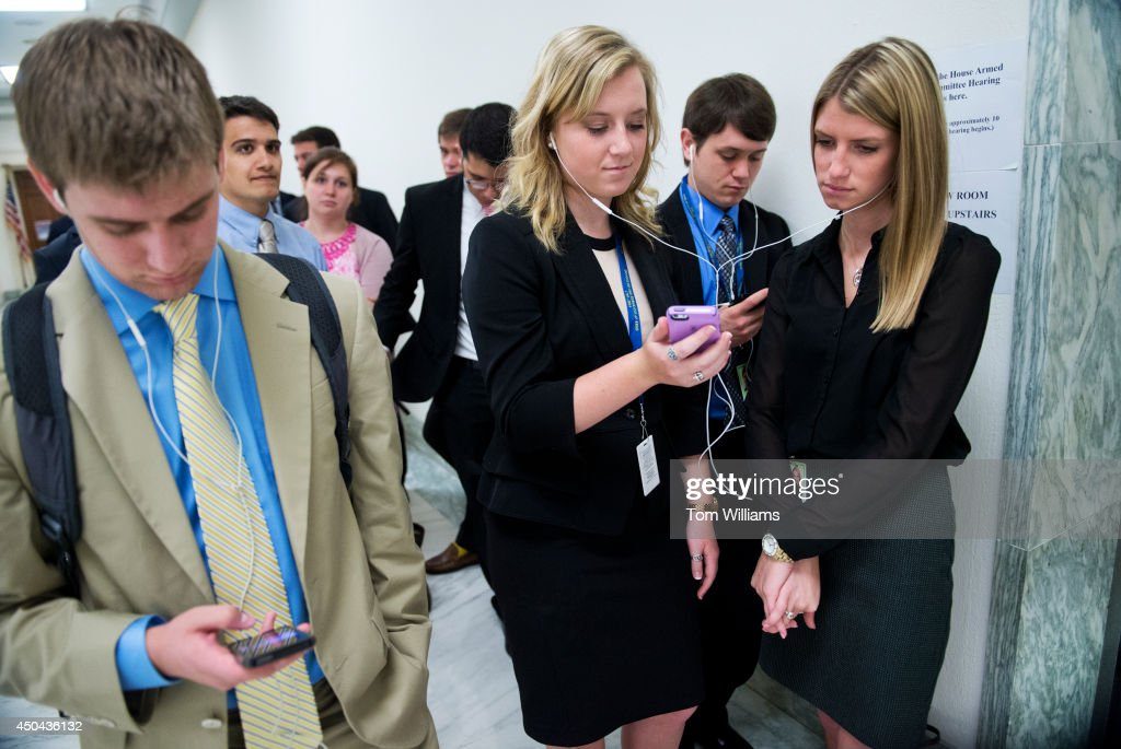 Jennifer Stubbs, center, and Megan Foreman, interns for Rep. Ralph Hall, R-Texas, wait in line to see Secretary of Defense Chuck Hagel testify before a House Armed Services Committee hearing in Rayburn Building on the Sgt. Bowe Bergdahl prisoner exchange, June 11, 2014.