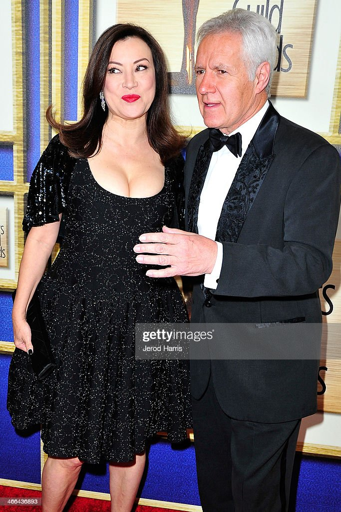 <a gi-track='captionPersonalityLinkClicked' href=/galleries/search?phrase=Jennifer+Tilly&family=editorial&specificpeople=202575 ng-click='$event.stopPropagation()'>Jennifer Tilly</a> and Alex Trenek arrive at the 2014 Writers Guild Awards L.A. Ceremony at JW Marriott Los Angeles at L.A. LIVE on February 1, 2014 in Los Angeles, California.
