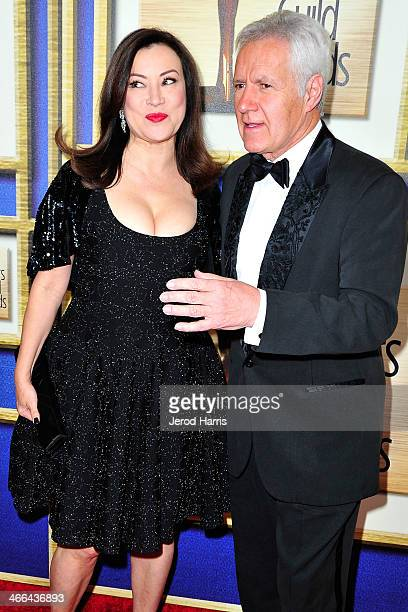 Jennifer Tilly and Alex Trenek arrive at the 2014 Writers Guild Awards LA Ceremony at JW Marriott Los Angeles at LA LIVE on February 1 2014 in Los...