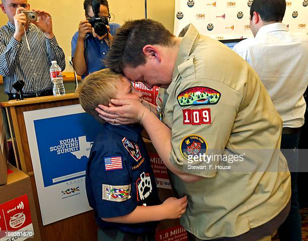 Jennifer Tyrrell of Bridgeport Ohio a Cub Scout den leader who was kicked out in 2012 for being openly gay embraces her son Cruz Burns before a news...