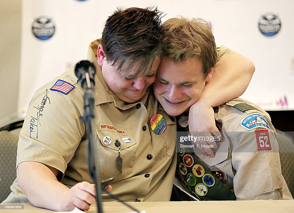 Jennifer Tyrrell of Bridgeport, Ohio, hugs Pascal Tessier, 16, of Kensington, Maryland, at a news conference held at the Great Wolf Lodge May 23, 2013 in Grapevine, Texas. The Boy Scouts of America today ended its policy of prohibitting openly gay youths from participating in Scout activities, while leaving intact its ban on gay adults and leaders. Jennifer was kicked out of the scouts as a Cub Scout den leader in 2012 for being openly gay. Pascal was told by Scout leaders that since he was openly gay he could not attain the Eagle Scout rank, but was permitted to remain a Scout. After today's decision, he will be able to resume his pursuit of the Eagle Scout rank.