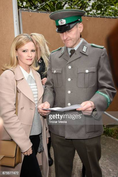 Jennifer Ulrich with a DDR customs officer at the Good bye Lenin Revival Premiere on May 1 2017 in Berlin Germany