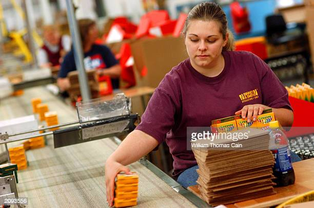 Jennifer Wambole places packaged crayons into boxes for shipping at Binney and Smith Inc the manufacturer of Crayola crayons June 18 2003 in Easton...