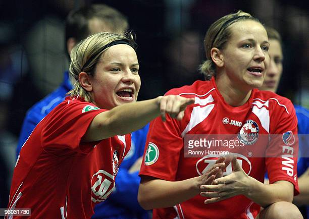 Jennifer Zietz and Viola Odebrecht of 1 FFC Turbine Potsdam gesture during the THome DFB Indoor Cup at the Boerdelandhalle on January 23 2010 in...