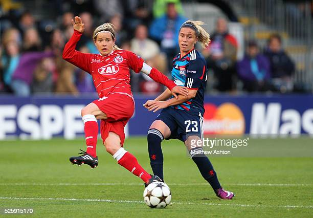 Jennifer Zietz of FFC Turbine Potsdam and Camille Abily of Olympique Lyonnais