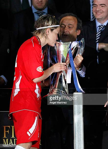 Jennifer Zietz of FFC Turbine receives the trophy from UEFA President Michel Platini after the UEFA Women's Champions League Final match between...
