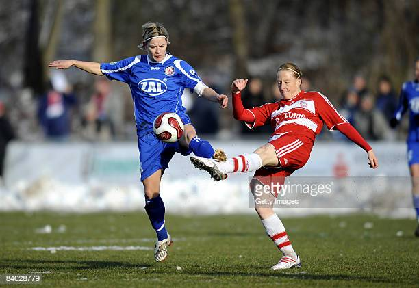 Jennifer Zietz of Potsdam and Melanie Behringer of Muenchen battle for the ball during the Women Bundesliga match between Bayern Muenchen and FFC...