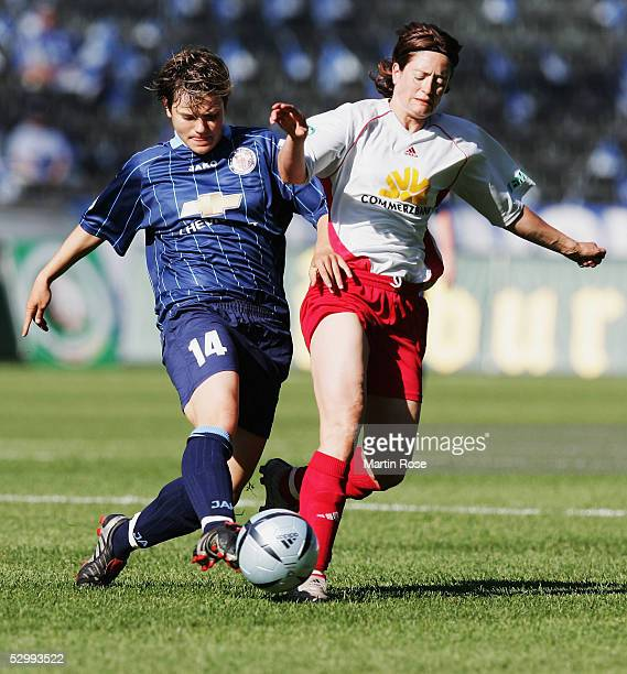 Jennifer Zietz of Potsdam attacks Renate Lingor of Frankfurt during the women German Football Federations Cup Final betweenTurbine Potsdam and FFC...