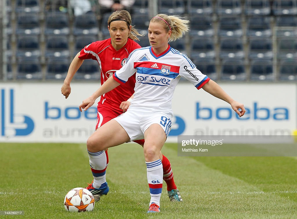 Jennifer Zietz (L) of Potsdam battles for the ball with Eugenie le Sommer (R) of Lyonnais during the second UEFA Women's Champions League semi final match between Turbine Potsdam and Olympique Lyonnais at Karl Liebknecht stadium on April 22, 2012 in Potsdam, Germany.