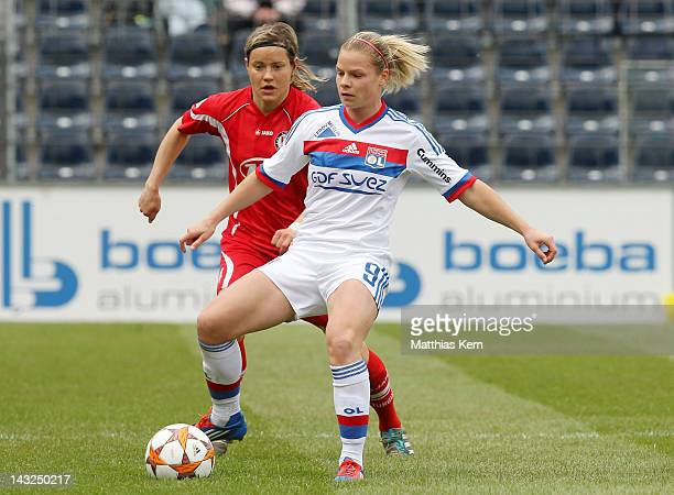 Jennifer Zietz of Potsdam battles for the ball with Eugenie le Sommer of Lyonnais during the second UEFA Women's Champions League semi final match...