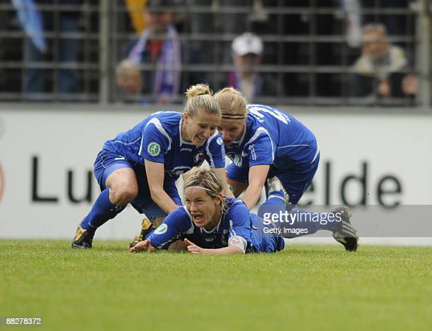 Jennifer Zietz of Potsdam celebrate the first goal with Anja Mittag and Tabea Kemme during the Women Bundesliga match between FFC Turbine Potsdam and...