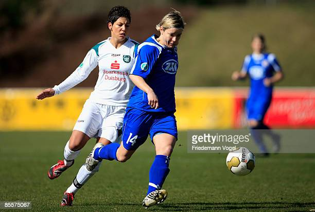 Jennifer Zietz of Potsdam is challenged by Linda Bresonik of Duisburg during the Women's Bundesliga match between FCR 2001 Duisburg and FFC Turbine...