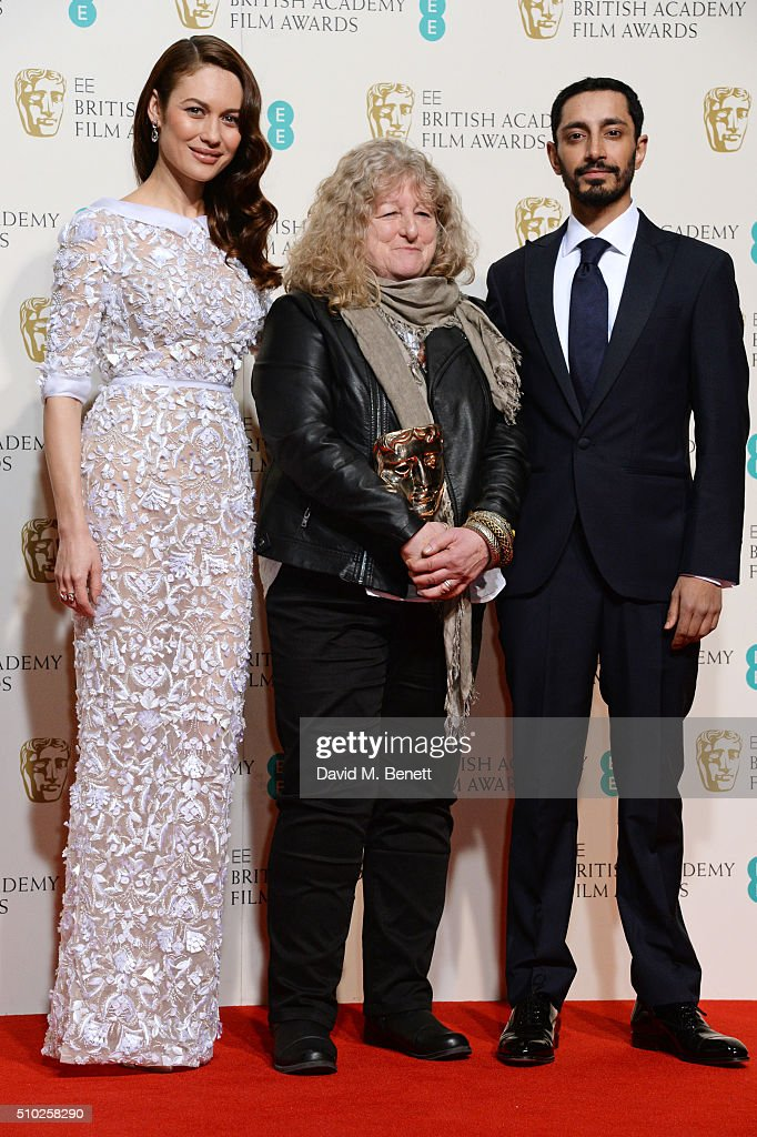 <a gi-track='captionPersonalityLinkClicked' href=/galleries/search?phrase=Jenny+Beavan&family=editorial&specificpeople=4585935 ng-click='$event.stopPropagation()'>Jenny Beavan</a> (C), winner of the Costume Design award for 'Mad Max: Fury Road', poses with presenters <a gi-track='captionPersonalityLinkClicked' href=/galleries/search?phrase=Olga+Kurylenko&family=editorial&specificpeople=630281 ng-click='$event.stopPropagation()'>Olga Kurylenko</a> (L) and <a gi-track='captionPersonalityLinkClicked' href=/galleries/search?phrase=Riz+Ahmed+-+Actor&family=editorial&specificpeople=9684228 ng-click='$event.stopPropagation()'>Riz Ahmed</a> in the winners room at the EE British Academy Film Awards at The Royal Opera House on February 14, 2016 in London, England.