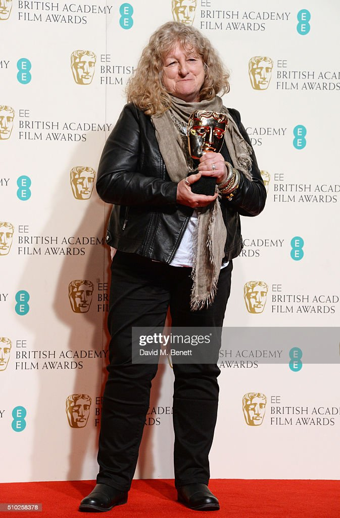 Jenny Beavan, winner of the Costume Design award for 'Mad Max: Fury Road', poses in the winners room at the EE British Academy Film Awards at The Royal Opera House on February 14, 2016 in London, England.