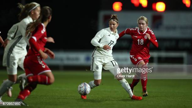 Jenny Beyer of Germany and Mathilde Rasmussen of Denmark compete for the ball during the U16 Girls international friendly match betwwen Denmark and...