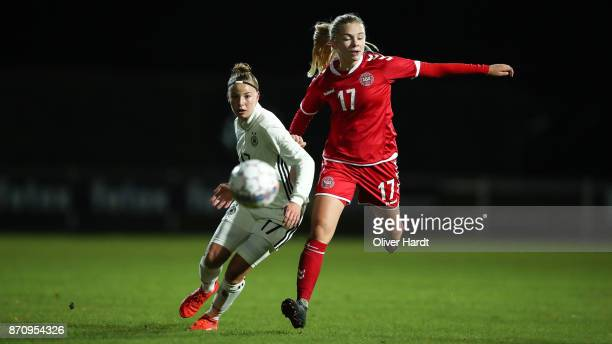 Jenny Beyer of Germany and Sofie Lundgaard of Denmark compete for the ball during the U16 Girls international friendly match betwwen Denmark and...