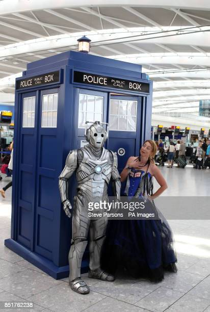 Jenny Colgan who is author of Doctor Who Dark Horizons with a Cyberman and a TARDIS at Terminal 5 of Heathrow Airport as part of a summer promotion...