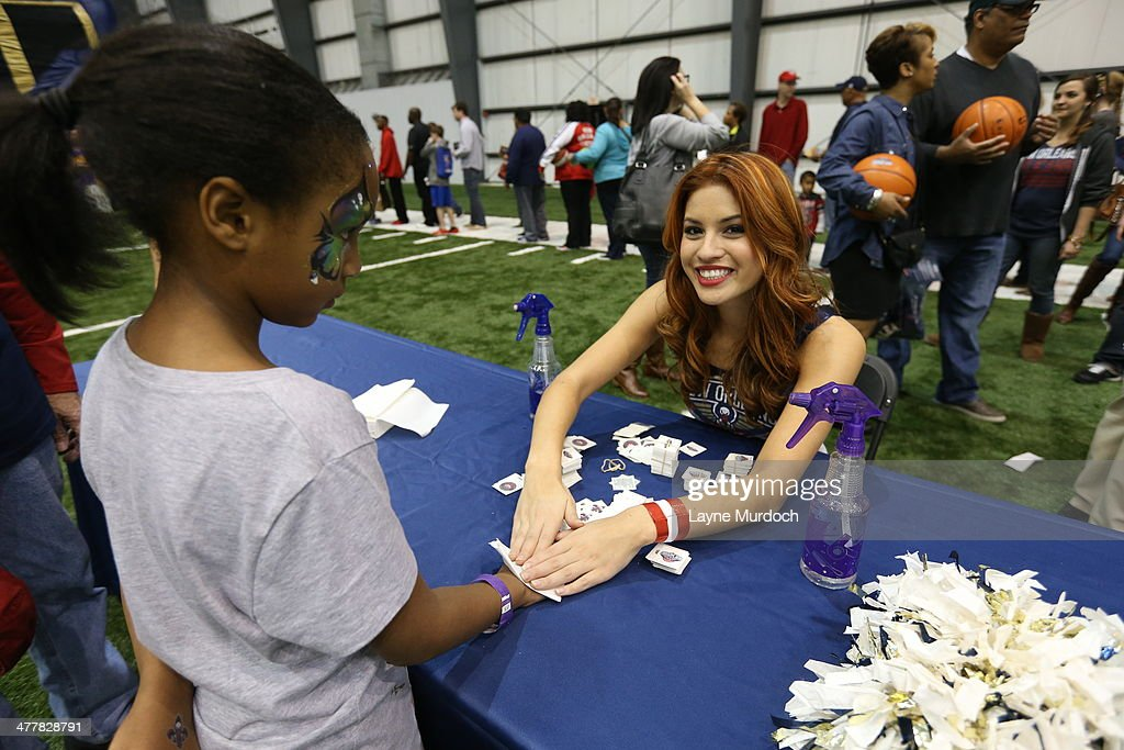 Jenny Craig of the New Orleans Pelicans Dance Team helps the organization host a season ticket holders event on March 8, 2014 at the New Orleans Pelicans practice facility in Metairie, Louisiana.