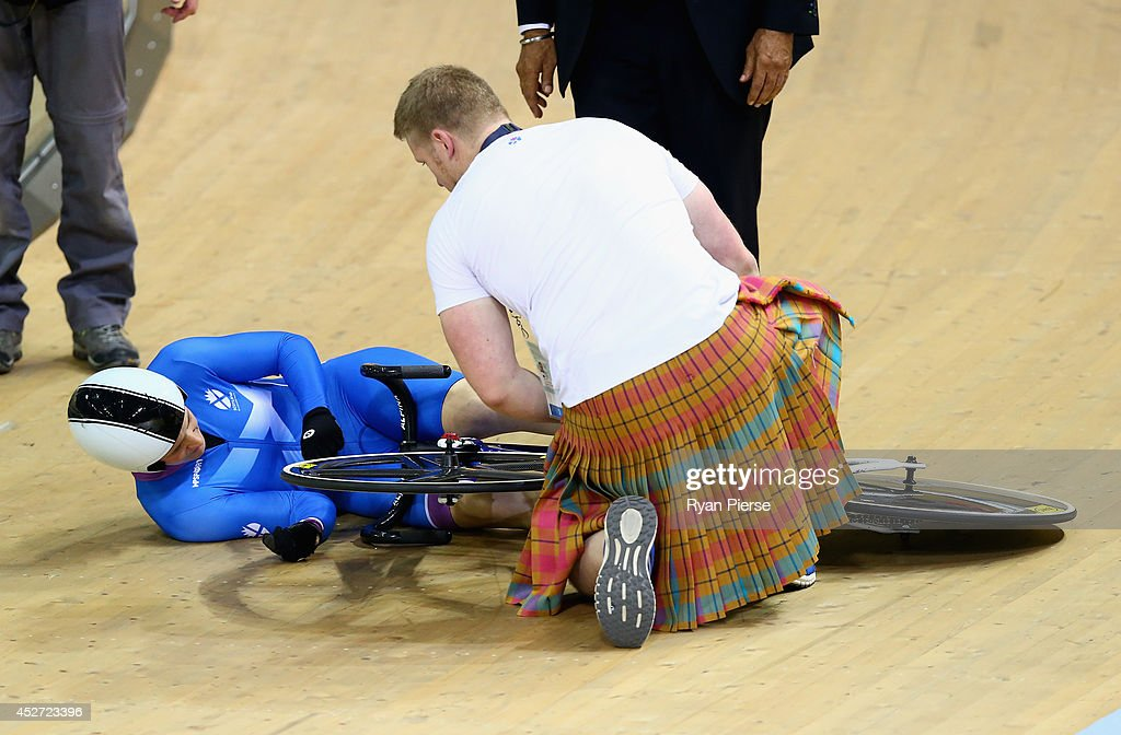Jenny Davis of Scotland is checked by officials after crashing in the Women's Sprint 5th-8th Place Race at Sir Chris Hoy Velodrome during day three of the Glasgow 2014 Commonwealth Games on July 26, 2014 in Glasgow, United Kingdom.