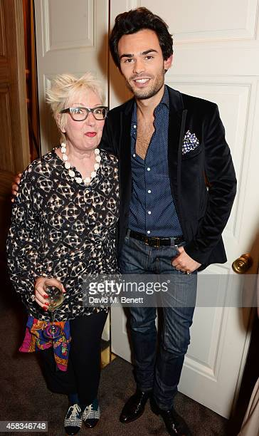 Jenny Eclair and Mark Francis Vandelli attend a fundraising event for The Eve Appeal at Claridge's Hotel on November 3 2014 in London England