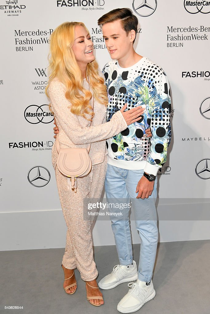 Jenny Elvers and her son Paul attend the Guido Maria Kretschmer show during the Mercedes-Benz Fashion Week Berlin Spring/Summer 2017 at Erika Hess Eisstadion on June 29, 2016 in Berlin, Germany.