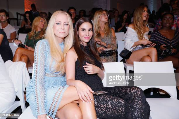 Jenny Elvers and Sila Sahin attend the Riani Fashion Show Spring/Summer 2018 at Umspannwerk Kreuzberg on July 4 2017 in Berlin Germany
