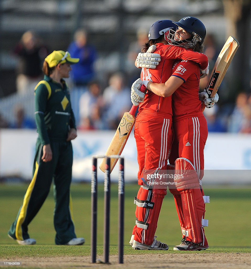 Jenny Gunn and Natalie Sciver of England celebrate the teams win and series win during the England Women and Australia Women Ashes Series - 3rd NatWest ODI at The BrightonandHoveJobs.com County Ground on August 25, 2013 in Hove, England.