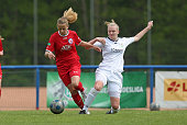 Jenny Hipp of Potsdam battles for the ball with Annalena Rieke of Guetersloh during the U17 Girl's Bundesliga semi final first leg match between...