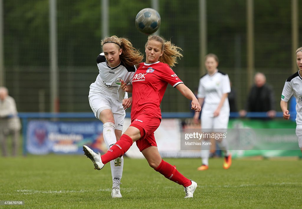 Jenny Hipp of Potsdam battles for the ball with Sophia Kleinherne of Guetersloh during the U17 Girl's Bundesliga semi final first leg match between...