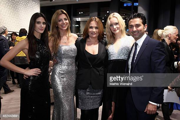 Jenny Juergens and Shahin Moghadam attend the Unique Flagship Store Opening at the new 'Koe Bogen' on November 28 2013 in Duesseldorf Germany